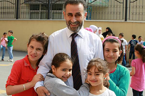 Professor Cuma Helps Refugee Children from His Home Country
