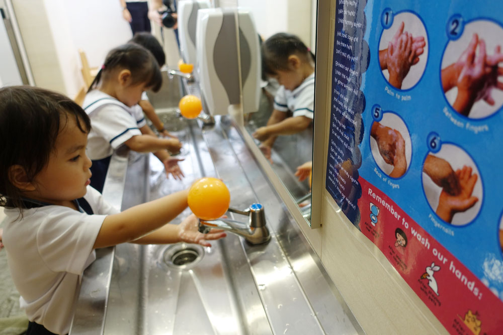 Image result for singapore children washing hands